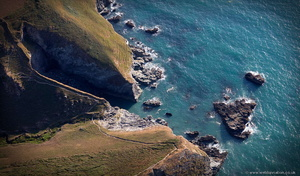rocky north coast of Cornwall showing the Coast Path at Jacket's Point from the air