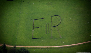 letters E II R laid out in stone walls near Chatsworth House  from the air