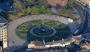 Queens Gardens Hull showing people sitting round the fountain on a summer evening.   aerial photograph