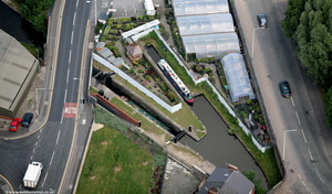 Canal lock on the Huddersfield Narrows Canal Ashton-under-Lynefrom the air
