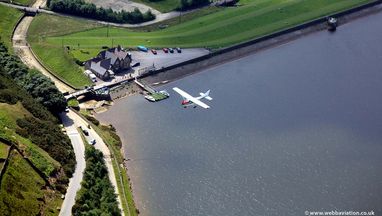 Cessna 172 flying over Cowm Reservoir from the air