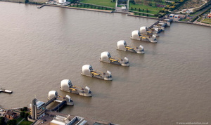 the Thames Barrier flood defenses London England UK aerial photograph