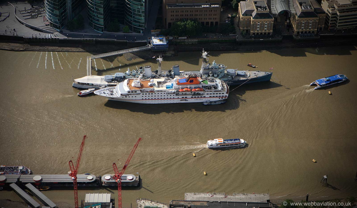 MS Hanseatic cuise ship moored next to HMS Belfast in London  from the air