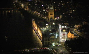 Elizabeth Tower and Big Ben restoration London at night from the air