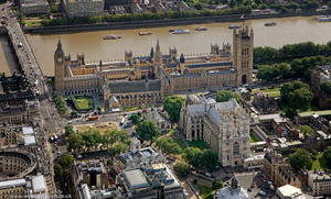 Westminster London England showing the Houses of Parliament and Westminster Abbey aerial photo