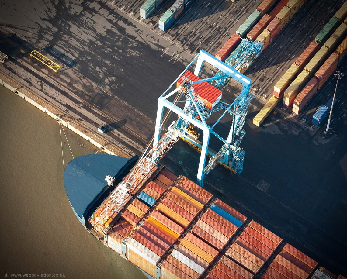container crane unloading the container ship at the Liverpool aerial photograph