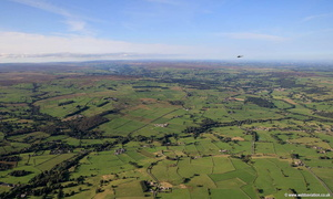 Bell Huey Helicopter over Menwith Hill Yorkshire  aerial photograph