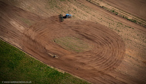 tractor ploughing in a circle from the air