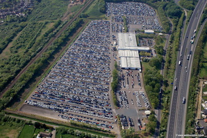 newly arrived BMW cars awaiting pre delivery inspection at BMW Thorne Distribution centre    aerial photograph