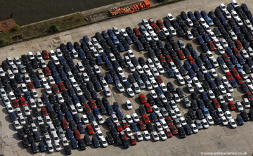 new cars on the dockside from the air