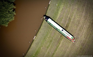 stranded Canal Boat on the River Avon at  the Barton,Warwickshire during the great floods of 2007 from the air