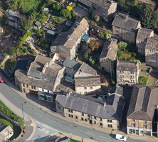 traditional stone cottages built higgledy-piggledy into the hillside in Holmfirth viewed  from the air